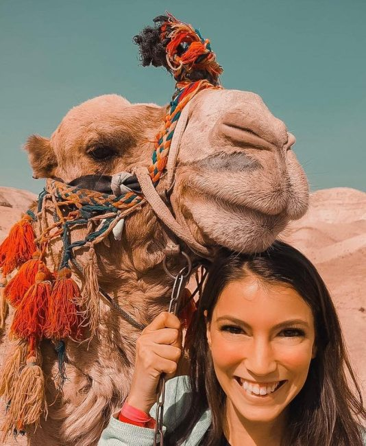 Sammie riding on camel