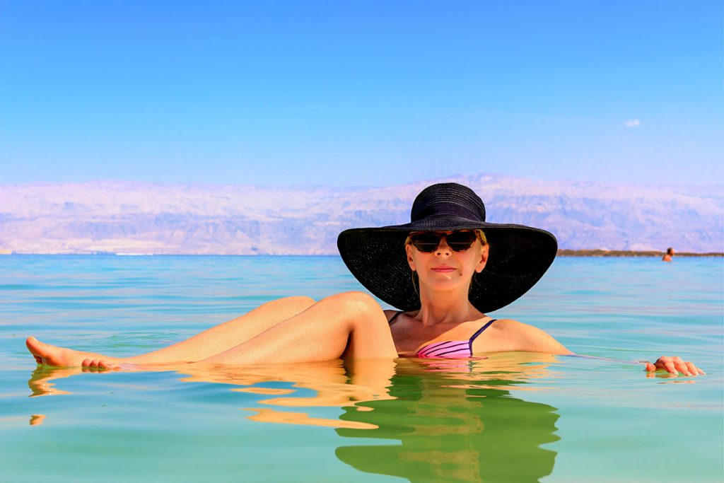 Top Things to See & Do in and Around the Dead Sea - Women Dipping